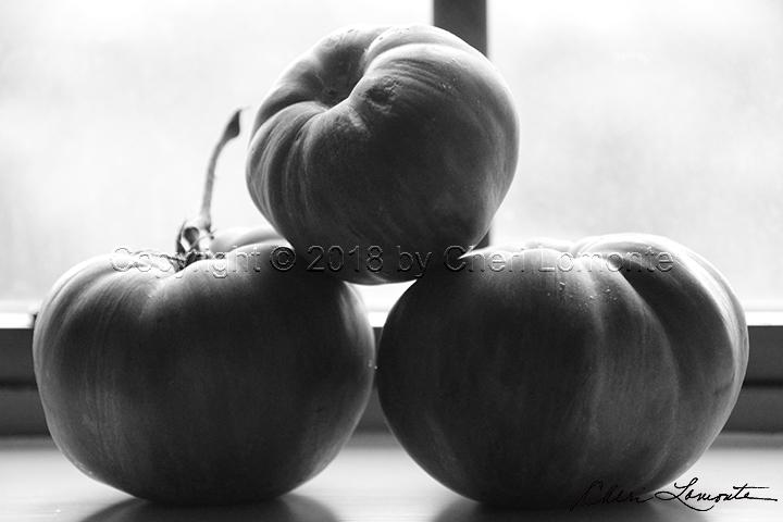 Tomato trio in black and white silhouette